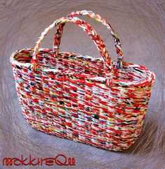 .a basket bag made of newspaper paperwicker