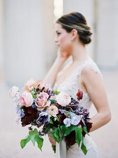 Wedding bouquet with dark and light hues; burgundy, peach, pink, lilac, periwinkle and green.