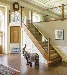 This beautiful dark oak in-line glass staircase has transformed this house. The in-line glass increases the light in the hallway and compliments the room.