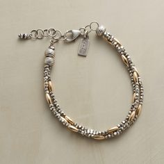 TIMES THREE BRACELET--Mixed metals multiplied by three. Smooth 14kt gold filled rice beads between segments of hammered sterling silver joined to links by grooved beads. Handcrafted in USA exclusively for us. Lobster clasp