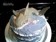 you could do a blue and white cake and put a toy shark on top...