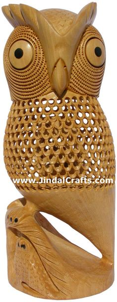 Gold Jewelry: Kt. This owl has been carved by a national award winner artistan. This masterpiece has been carved from single piece of wood. There is no joint in this sculpture. The main feature of this statue is that two more owls have been carved in a row under the belly of owl itself through small holes. | eBay!