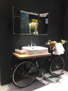35 Ideas for a Unique and Chic Bathroom. Pictured here is a recycle idea for an old bike! Via: homedit.com
