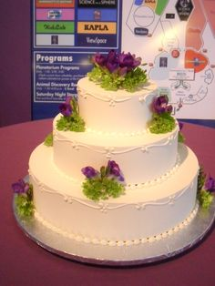 sweet and simple wedding cake with flourish border