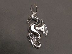 It's so precious.   Dragon pendant  Sterling silver  In stock by AnubisCollections, $100.00