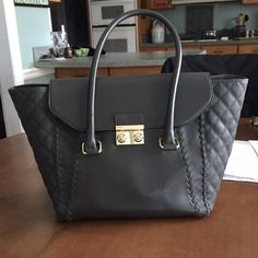 Dark grey charming Charlie purse Perfect condition! Lots of room on the inside! Charming Charlie Bags