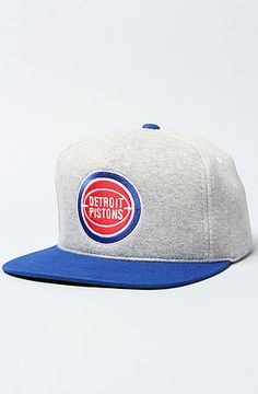 69701e447eef0 Mitchell   Ness The Detroit Pistons Heather Fleece Snapback Cap in Blue    Red Heather fleece snapback featuring a contrast flat brim and top button   ...