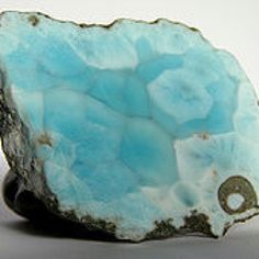 "Larimar. Also known as ""the dolphin stone'' and ""the stone of Atlantis"". Only found in one square km. in the entire world off the coast of the Dom. Republic"