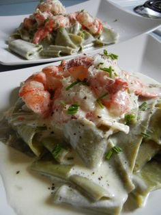 Lobster pappardelle with garlic cream sauce  I think you can also use scallops or even shrimp,,hummm  maybe crab or clams   I like this idea ciao