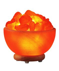 {Healing Embers Salt Lamp} carved from Himalayan salt, when heated it releases negative ions to clear the air. interesting!