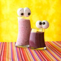Spooky Banana-Berry Smoothies    ingredients  2 cups fat-free plain yogurt  2 medium ripe bananas, peeled and frozen  1 cup sliced fresh strawberries or frozen unsweetened whole strawberries  1 cup mixed fresh berries (such as raspberries, blueberries, and/or blackberries) or frozen unsweetened mixed berries  1 tablespoon honey (optional)  1 recipe Ghostly Meringue Eyes