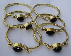 fair trade Cambodia. Jewellery made from recycled brass bomb shell hammered natural black stone cuffs, ethically handcrafted by disadvantaged home based workers.