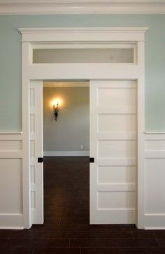 Double pocket doors with frosted glass transom add a nice finished touch to this doorway. Pocket doors are a great space saving option.