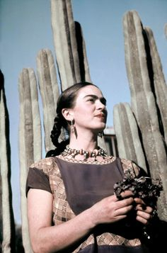 Frida Kahlo poses outside her home and studio in Mexico City circa 1940.