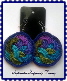 Crochet Earrings; No pattern. I'll have to attempt these on my own. I think they're simple enough, once I figure out what size to make one inner ring. Then loop them together and SC around the outside.