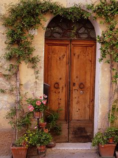 Flowered Tuscan Door. Tuscany, Italy. by Donna Corless.