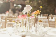 flower arrangements in clear glass vases // photo by Alixann Loosle