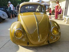 mustard yellow VW Beetle. Amber headlights