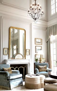 Traditional living room filled with glamorous velvet, fringe, crystal, giltwood and sky-high drapes.