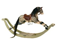 late 19thC large carved and painted dappled rocking horse, - Miller's Antiques & Collectables Price Guide