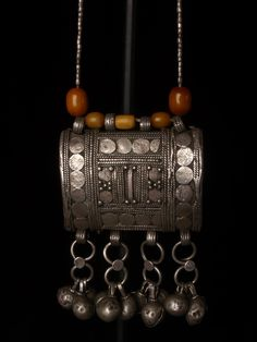 Amulet, Yemen Size of amulett 7,5 x 6,5 total length 40 cm. 3 x 2,6 x 15,7 inch Old and beautiful amulet in silver, and beads in glass silver and copal