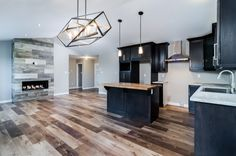 A look at the kitchen and living area in this custom home design in Bristolwood!