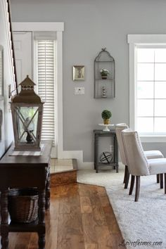 Living room grey wall with white trim