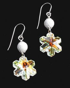This jewelry making Christmas holiday themed earring kit features Swarovski crystal ab snowflake pendants, silver plate stardust beads with sterling silver findings and shepherd hook earwires. Kit includes materials and how-to instructions. Metal Jewelry, Crystal Jewelry, Custom Jewelry, Beaded Jewelry, Handmade Jewelry, Jewlery, Yoga Jewelry, Crystal Earrings, Silver Jewelry