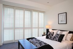 Tara Dennis bedroom window dressing - decorating ideas to help select the best drapes, curtains, blinds or shutters.