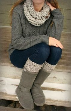 Adorable grey combination of woolen jaket ,scarf and winter boots with blue jean