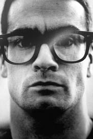Mr. Henry Rollins. (Remember him fromhis Black Flag days.....oof...)