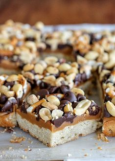 Fully Loaded Bars have an oat shortbread crust topped with peanut butter caramel, pretzels, chocolate chips, & roasted peanuts. Just Desserts, Delicious Desserts, Yummy Food, Healthy Desserts, Tasty, Baking Recipes, Cookie Recipes, Dessert Recipes, Bar Recipes