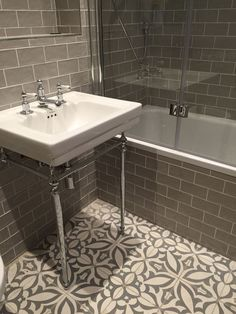 Vintage metro meets floral cement tiles in this stunning bathroom combination. Vintage metro me Bathroom Tile Designs, Bathroom Floor Tiles, Bathroom Ideas, Wall Tiles, Rv Bathroom, Remodel Bathroom, Master Bathroom, Cement Tiles Bathroom, Mosaic Bathroom