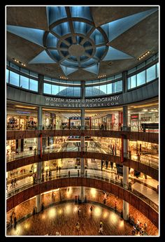 Next up: the Dubai Mall - a. the world's largest mall. Either take a cab to the nearest metro station and take the metro to the Dubai Mall station, or take a taxi all the way there. Dubai Mall, Dubai Shopping, Dubai City, Shopping Malls, Best Hotel Deals, Best Hotels, Abu Dhabi, Dubai Travel, Modern City