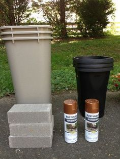 Create large, lovely planters by spray painting cheap plastic garbage cans.
