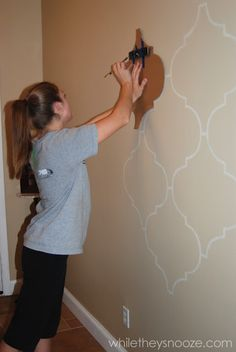 DIY Moroccan-Style Wall Stencil Tutorial - maybe a gray-purple wall with gray…