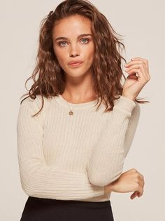Back to reality - sorry, fall is here. This is a slightly cropped sweater with a crew neck and long sleeves.