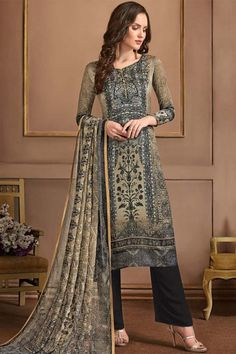 This Multi Colour Satin Georgette Printed Trouser Suit which will instantly catch your fancy. Matched with Santoon Trouser in Dark Grey Color with Multi Colour Georgette Printed Dupatta.