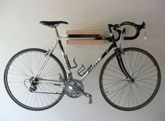 Utilizing a single stud, the bike shelf can be hung basically anywhere.  14″ deep, 14″ wide, with a 2 inch frame opening