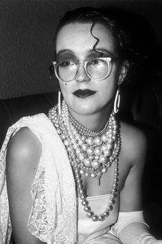 New romantic woman wearing pearls and glasses at The Blitz club....