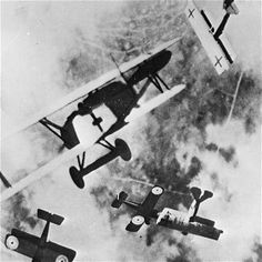A dogfight involving German Fokker VIIs and British SE5 fighters, as flown by Mannock