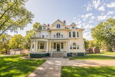Only FOUR families have ever owned this magnificent home, built in the 1880 range, with plans by architect George F. Barber.  On a quiet street in small town Iowa sits this 4-5 bedroom Victorian home with original & intricate woodwork; unique, refinished hardwood floors; pocket doors; leaded windows & doors; historic fixtures; two fireplaces with original surrounds; marble sinks; built-ins & more! Updated with geothermal heat and newer kitchen, roof & gutters.  Who will be owner #5?