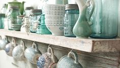 Hanging cups or mugs under a cabinet or shelf is a great way to free up cabinet space and makes them easily accessed for guests.