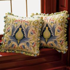 Thistle Needlepoint Pillow- pillows like these with beautiful fringe can make a room. Don't skimp here! It's these small things that count.