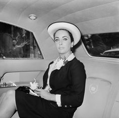 This smart, wide-brimmed white and black hat was paired with a black dress in 1960.