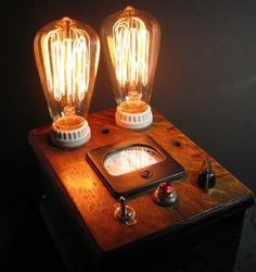 This is a one-of-a-kind Steampunk Lamp such as a Mad Scientist might have on his workbench. This is a STUNNING rustic vintage lamp! There are two bulbs controlled by a Dimmer Knob so you can get ambient lighting on a shelf or a bright bedside reading lamp. #steampunk #edison #lightbulb #tablelamp #vintage #bedside #rustic #lamp