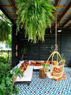 a boho-inspired patio with swing chair