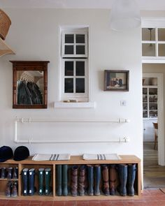 Great idea for entryway - seat to sit on with storage underneath