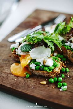 Green sandwich with a poached egg.