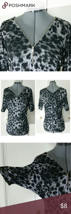 "FREE with Bundle Size S/M - Dolman Top Small January 7 Animal Print Size Small Top Decorative Zipper  This top has some wear, minor flaw barely noticeable ***see last photo***missing size tag, check measurements and compare with a garment you already have.  Measurements laying flat: Armpit to armpit: 18"" Neck to Hem: 27""  Sold as is Thanks,  Item# B20 January 7 Tops"